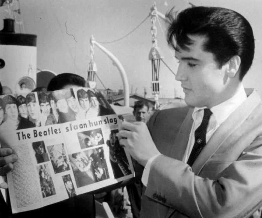 Elvis looks at Beatles magazine