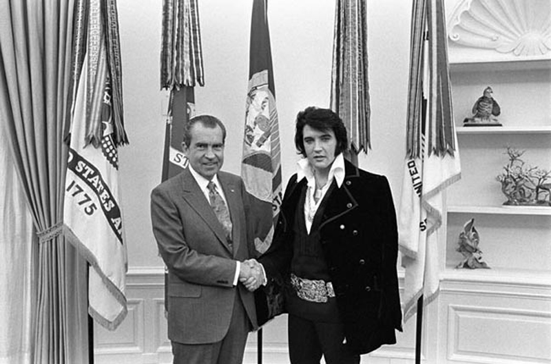 President Nixon shakes hands with entertainer Elvis Presley in the Oval Office